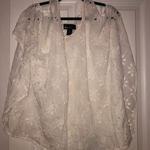 Fun cold shoulder flowy top with flower cutouts